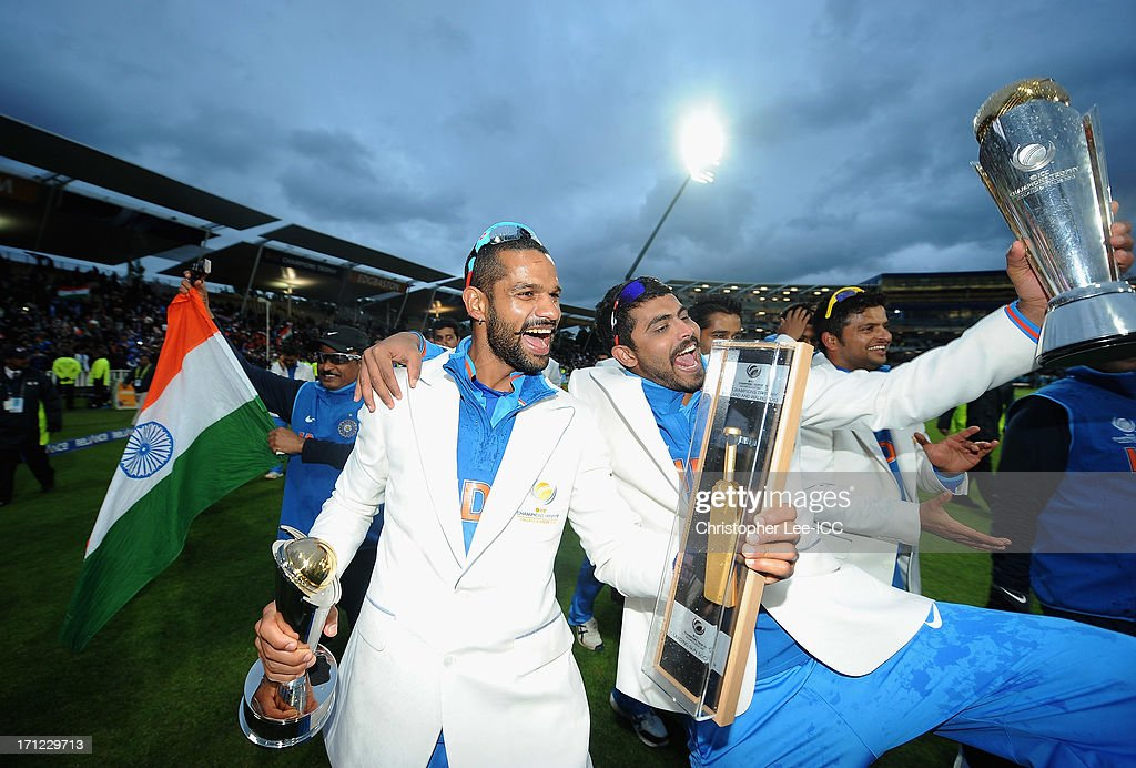 Shikhar Dhawan and Ravindra Jadeja (R) of India celebrate their victory with their player awards and the Champions Trophy after the ICC Champions Trophy Final match between England and India at Edgbaston on June 23, 2013 in Birmingham, England.