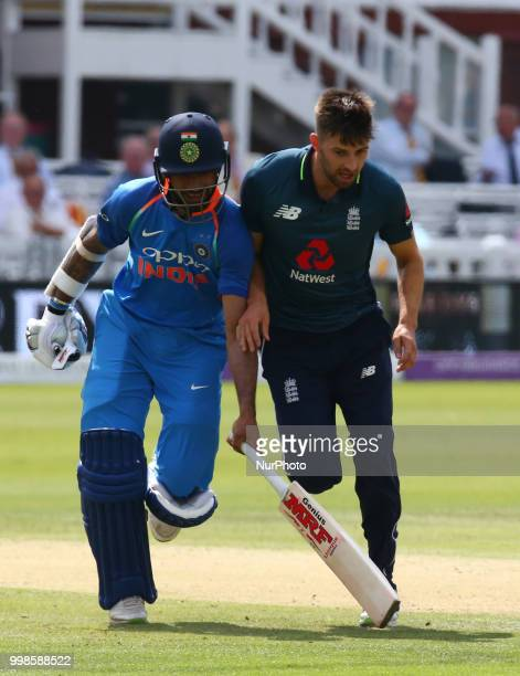 LR Shikhar Dhawan of India and England's Mark Wood during 2nd Royal London One Day International Series match between England and India at Lords...