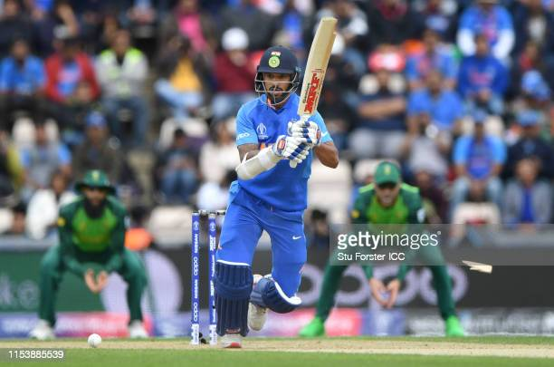 Shikhar Dhawan of India breaks his bat as he plays a shot during the Group Stage match of the ICC Cricket World Cup 2019 between South Africa and...