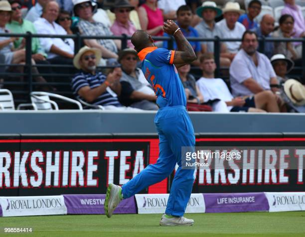 Shikhar Dhawan of India catches England's Eoin Morgan during 2nd Royal London One Day International Series match between England and India at Lords...