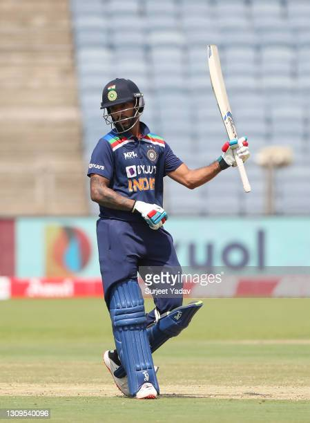 Shikhar Dhawan of India celebrates after reaching their half century during the 3rd One Day International match between India and England at MCA...