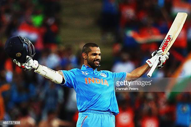 Shikhar Dhawan of India celebrates after scoring a century during the 2015 ICC Cricket World Cup match between Ireland and India at Seddon Park on...