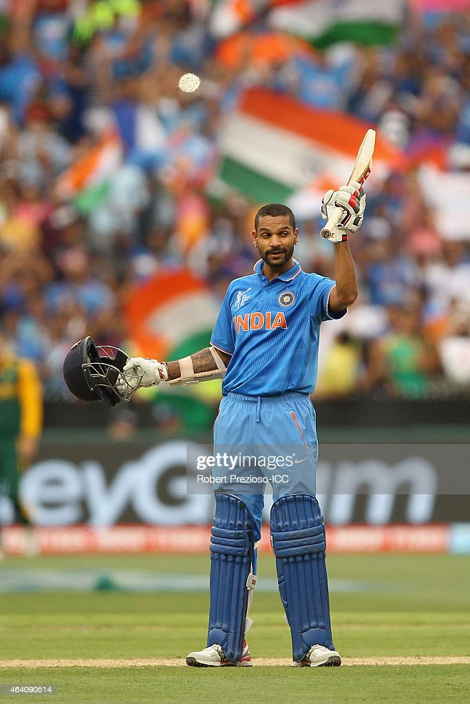 Shikhar Dhawan of India celebrates after scoring his century during the 2015 ICC Cricket World Cup match between South Africa and India at Melbourne Cricket Ground on February 22, 2015 in Melbourne, Australia.
