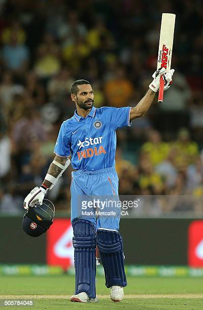 Shikhar Dhawan of India celebrates and acknowledges the crowd after scoring a century during the Victoria Bitter One Day International match between...