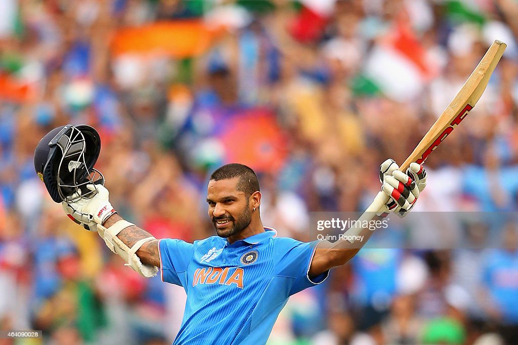 Shikhar Dhawan of India celebrates making a century during the 2015 ICC Cricket World Cup match between South Africa and India at Melbourne Cricket Ground on February 22, 2015 in Melbourne, Australia.