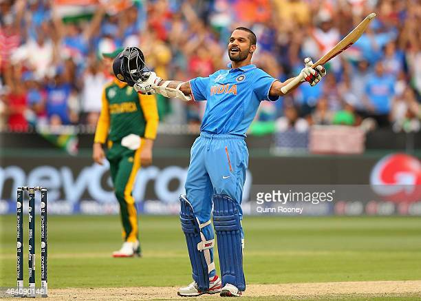 Shikhar Dhawan of India celebrates making a century during the 2015 ICC Cricket World Cup match between South Africa and India at Melbourne Cricket...