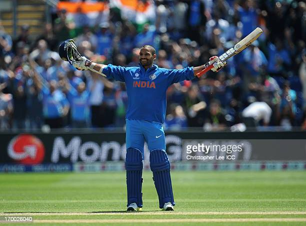 Shikhar Dhawan of India celebrates scoring his century during the ICC Champions Trophy group B match between India and South Africa at Cardiff...
