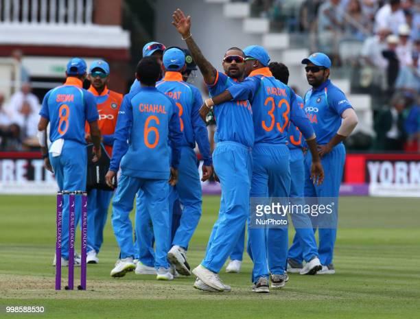 Shikhar Dhawan of India celebrates the catch of England's Eoin Morgan bowled by Kuldeep Yadav of India during 2nd Royal London One Day International...