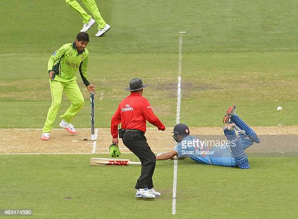 Shikhar Dhawan of India dives for his crease but is run out during the 2015 ICC Cricket World Cup match between India and Pakistan at Adelaide Oval...
