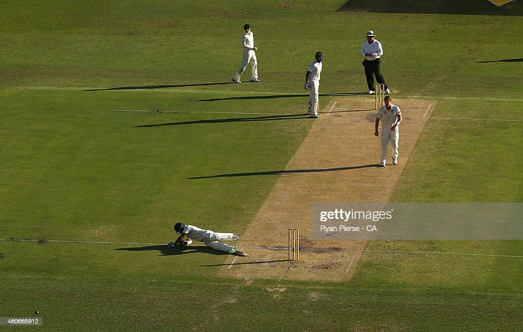 Shikhar Dhawan of India falls over while trying to avoid a ball thrown by Shane Watson of Australia during day three of the 2nd Test match between Australia and India at The Gabba on December 19, 2014 in Brisbane, Australia.