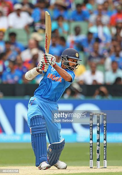 Shikhar Dhawan of India hits a boundry during the 2015 ICC Cricket World Cup match between South Africa and India at Melbourne Cricket Ground on...