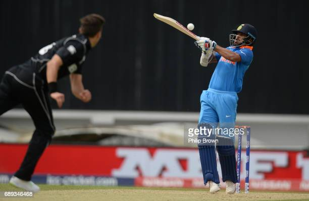 Shikhar Dhawan of India hits a delivery bowled by Trent Boult of New Zealand during the ICC Champions Trophy Warmup match between India and New...