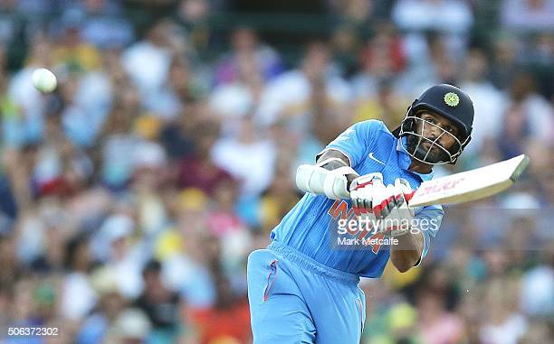 Shikhar Dhawan of India hits a six during game five of the Commonwealth Bank One Day Series match between Australia and India at Sydney Cricket...
