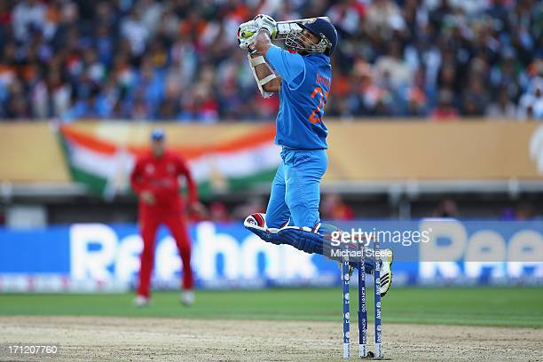 Shikhar Dhawan of India hits a six over backward point off the bowling of Stuart Broad of England during the ICC Champions Trophy Final match between...