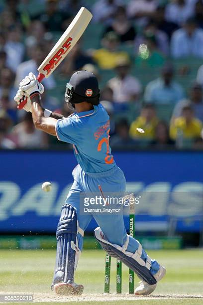 Shikhar Dhawan of India is bowled by John Hastings of Australia during game three of the One Day International Series between Australia and India at...