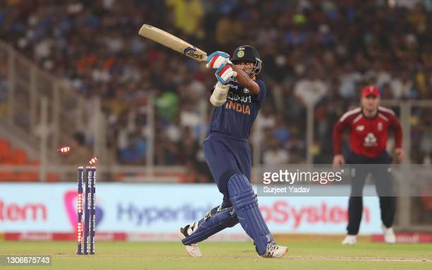 Shikhar Dhawan of India is bowled by Mark Wood of England for 4 during the 1st T20 International match between India and England at Sardar Patel...