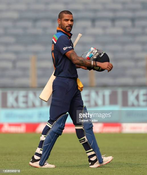 Shikhar Dhawan of India leaves the field after being dismissed by Ben Stokes of England during 1st One Day International between India and England at...