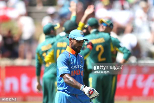 Shikhar Dhawan of India leaves the field after losing his wicket during the 3rd Momentum ODI match between South Africa and India at PPC Newlands on...