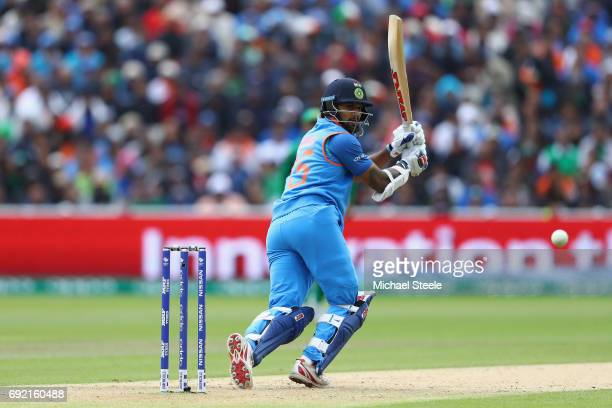 Shikhar Dhawan of India plays to fine leg during the ICC Champions Trophy match between India and Pakistan at Edgbaston on June 4 2017 in Birmingham...