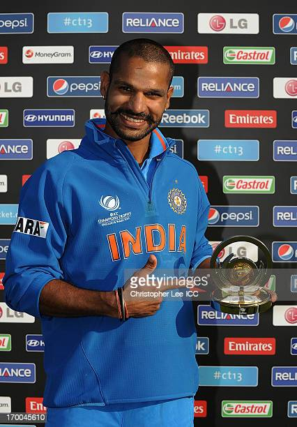 Shikhar Dhawan of India poses with his Man of the Match award during the ICC Champions Trophy group B match between India and South Africa at Cardiff...