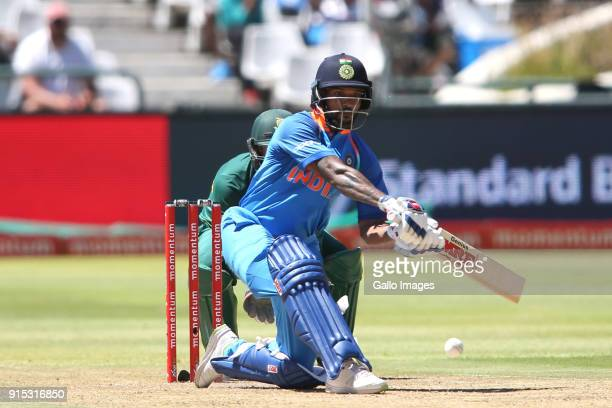 Shikhar Dhawan of India sweeps a delivery to bring up his fifty during the 3rd Momentum ODI match between South Africa and India at PPC Newlands on...
