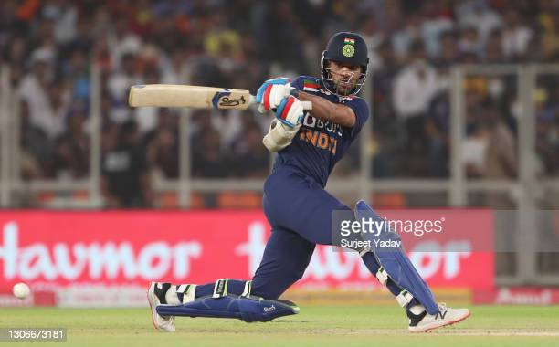 Shikhar Dhawan of India sweeps the ball during the 1st T20 International match between India and England at Sardar Patel Stadium on March 12, 2021 in...