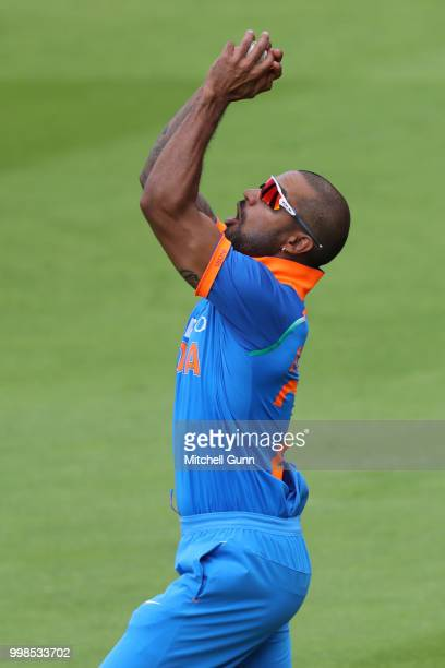 Shikhar Dhawan of India takes a catch to dismiss Eoin Morgan of England during the 2nd Royal London One day International match between England and...