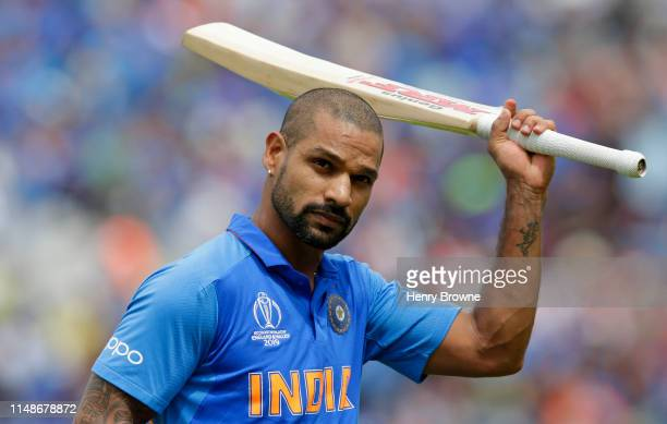 Shikhar Dhawan of India walks off after being caught out during the Group Stage match of the ICC Cricket World Cup 2019 between India and Australia...