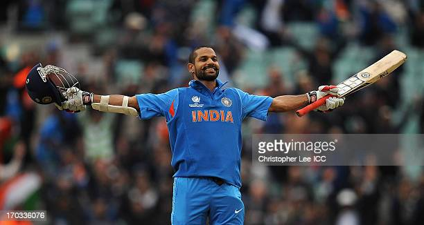 Shikhar Dhawan of Indian celebrates scoring his century during the ICC Champions Trophy Group B match between India and West Indies at The Oval on...