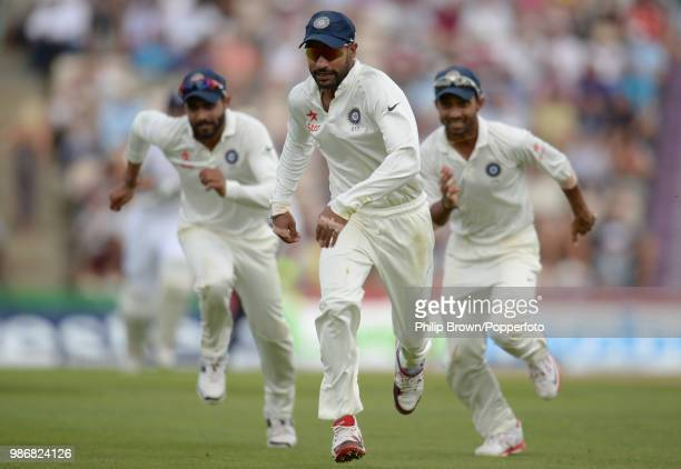Shikhar Dhawan Ravi Jadeja and Ajinkya Rahane of India chase after the ball during the 3rd Test match between England and India at the Ageas Bowl...
