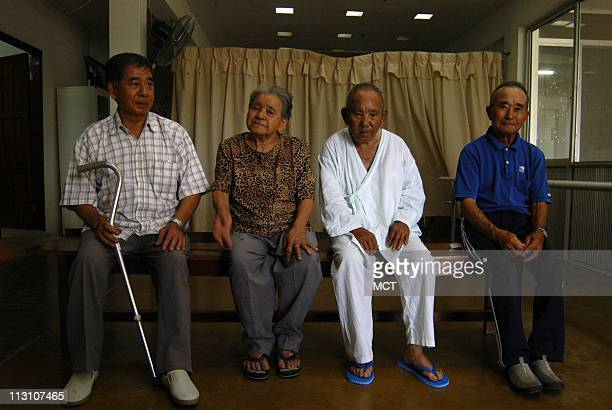 Shiko Asato left and Hanako Higa second from left founders of the Okinawa Japanese farmers colony in eastern Bolivia in 1954 December 21 2005 The...