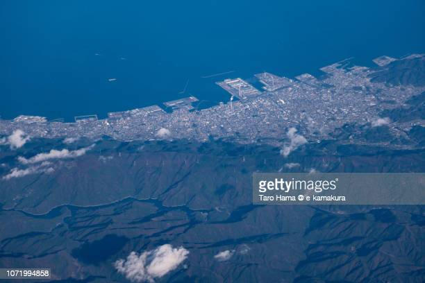 Shikokuchuo city in Ehime prefecture and Seto Inland Sea in Japan daytime aerial view from airplane