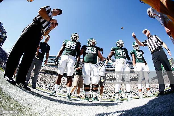 Shilique Calhoun Travis Jackson Taiwan Jones Kurtis Drummond of the Michigan State Spartans during the coin toss against the Wyoming Cowboys at...