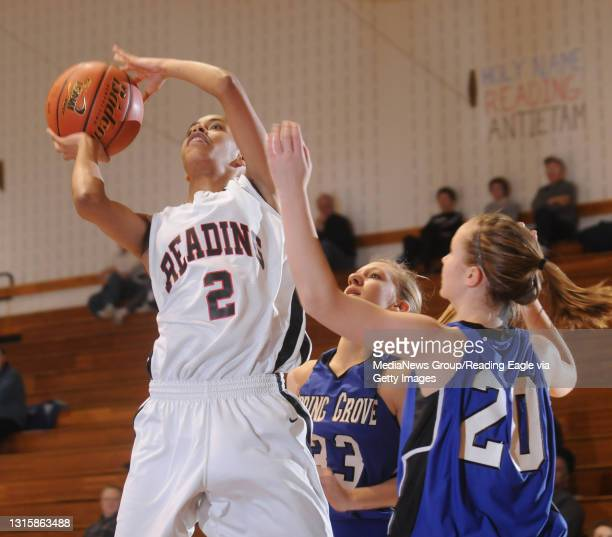Shillington, PAReading High's Deva'Nyar Workman goes up to the basket against Spring Grove's Cari McMaster and Allie Garrett .Scholastic Girls...