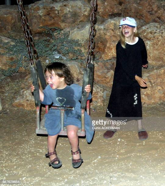 Shilo children play on swing set in the community Shilo is a large West Bank settlement located north of Jerusalem was once a capital of the ancient...