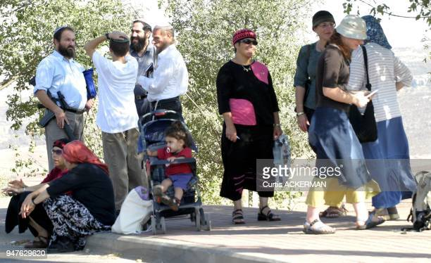 Shilo men armed with M16 and women congragate near the bus stop Shilo is a large West Bank settlement located north of Jerusalem was once a capital...