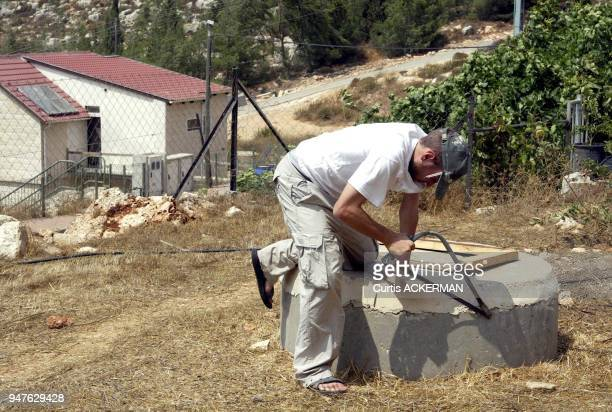 A Shilo resident making repairs to his West Bank home Shilo is a large West Bank settlement located north of Jerusalem was once a capital of the...