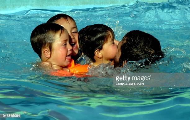 A Shilo settler father enjoys the afternoon in the Shilo community pool with his children Shilo is a large West Bank settlement located north of...
