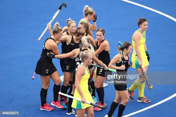 Shiloh Gloyn of New Zealand is congratulated by her teammates after scoring the first goal during the Women's Gold Medal match between Australia and...