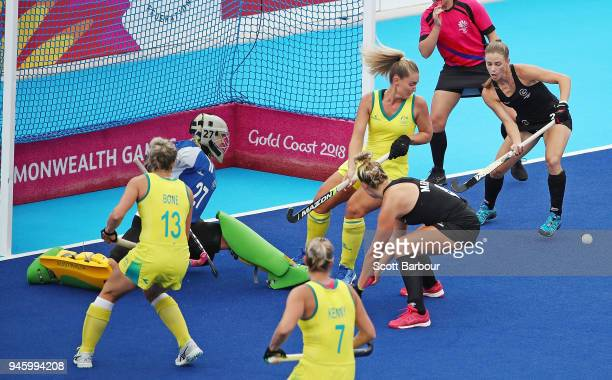 Shiloh Gloyn of New Zealand misses a shot on goal during the Women's Gold Medal match between Australia and New Zealand during the Hockey on day 10...