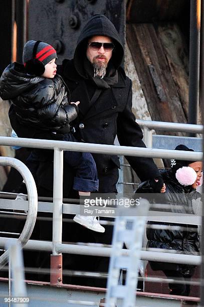 Shiloh JoliePitt actor Brad Pitt and Zahara JoliePitt visit the Salt film set at Pier 66 on December 29 2009 in New York City