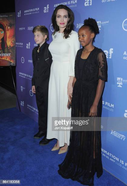 Shiloh JoliePitt Angelina Jolie and Zahara JoliePitt arrive at the premiere of Gkids' The Breadwinner at TCL Chinese 6 Theatres on October 20 2017 in...