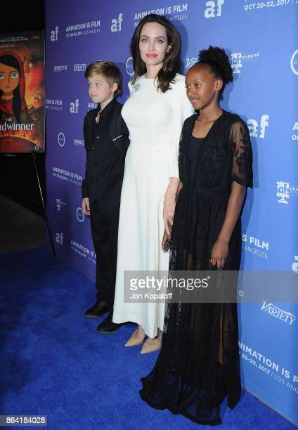 Shiloh JoliePitt Angelina Jolie and Zahara JoliePitt arrive at the premiere of Gkids' 'The Breadwinner' at TCL Chinese 6 Theatres on October 20 2017...