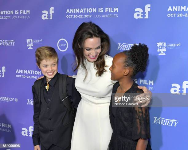Shiloh JoliePitt Angelina Jolie and Zahara JoliePitt attend the Premiere Of Gkids' 'The Breadwinner' at TCL Chinese 6 Theatres on October 20 2017 in...