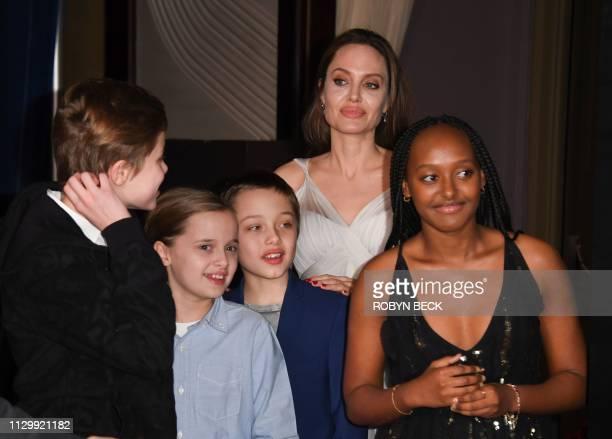Shiloh JoliePitt Vivienne Marcheline JoliePitt Knox JoliePitt US actress Angelina Jolie and Zahara Marley JoliePitt arrive for the world premiere of...