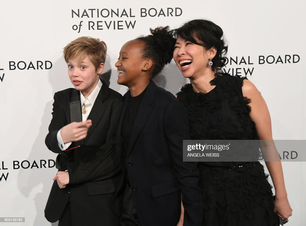 TOPSHOT - Shiloh Jolie-Pitt, Zahara Jolie-Pitt, and Loung Ung attend the 2018 National Board of Review Awards Gala at Cipriani 42nd Street on January 9, 2018 in New York City. /