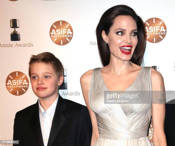 Shiloh Nouvel JoliePitt and mother actress Angelina Jolie attend the 45th Annual Annie Awards at Royce Hall on February 3 2018 in Los Angeles...