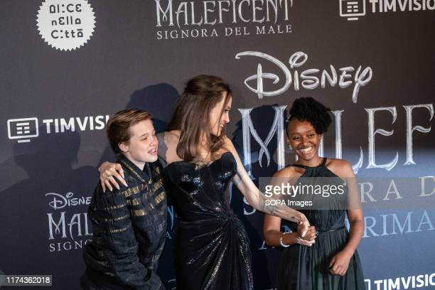 """Shiloh Nouvel Jolie-Pitt, Angelina Jolie and Zahara Marley Jolie-Pitt attend the European premiere of the movie """"Maleficent Mistress Of Evil"""" at..."""