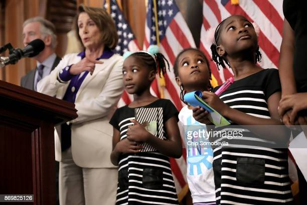 Shiloh Tappin and her twin sister Seilah Tappin and their friend Dani Hebron all 7 years old take notes during a news conference conducted by House...
