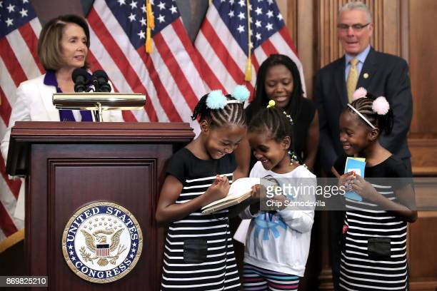 Shiloh Tappin her twin sister Seilah Tappin and their friend Dani Hebron all 7 years old take notes during a news conference conducted by House...